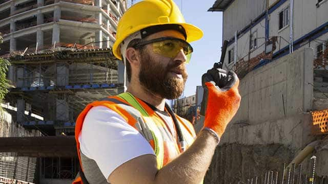 Worker on jobsite following OSHA rules