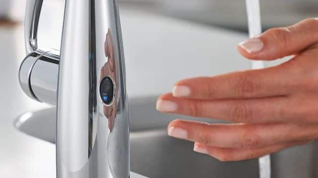 Touchless bathroom faucets and sinks
