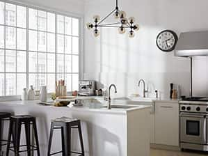 Modern kitchen with double Kohler Artifacts faucets