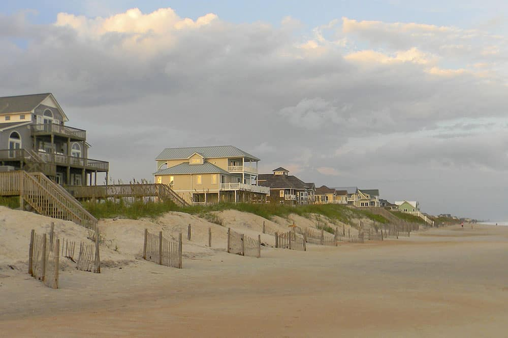 Outer Banks NC beach houses and sand dunes.